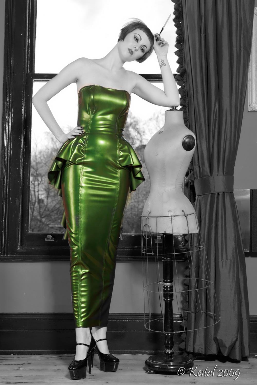 Sculptural Peplum Dress